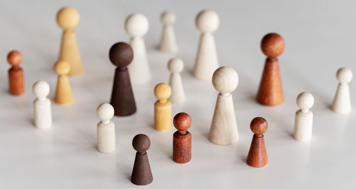 high-view-diverse-wooden-characters-inclusion-concept